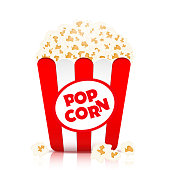 Popcorn vector, realistic illustration. Flakes of popcorn in a paper cup in red and white stripes, isolated on white