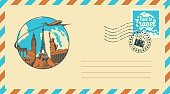 Postal envelope with stamp and rubber stamp. Illustration on the theme of travel with architectural and historical sights, passenger aircraft and the words Time to travel