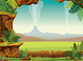 Prehistoric cartoon landscape - green ferns, grass, smoking volcanoes and stone cave on a blue sky. Vector nature illustration.