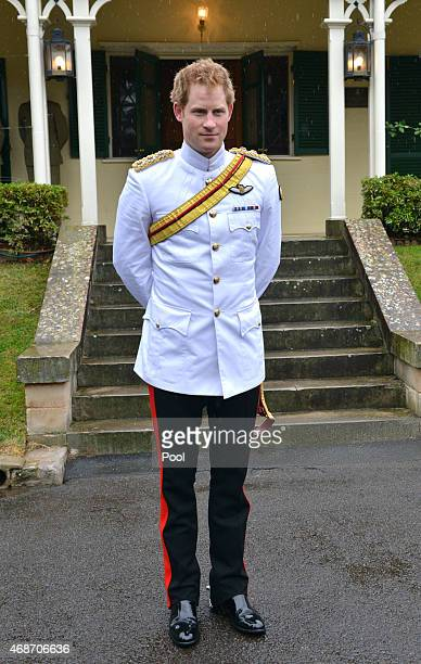 Prince Harry stands outside Duntroon House after arriving at the Royal Military College Duntroon on April 6 2015 in Canberra Australia Prince Harry...