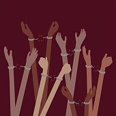 Prisoners or Slaves victims of trafficking with Hands breaking free from Handcuffs - oppression or freedom Concept