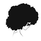 black silhouette of a girl with hair volume
