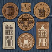 set of leather labels on denim on the theme pub with live music