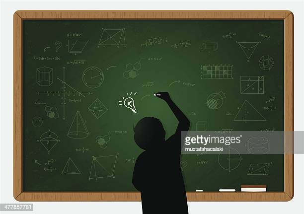 Pupil writing on chalkboard