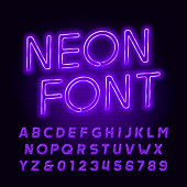 Purple neon tube alphabet font. Neon color oblique letters and numbers. Stock vector typeface for your headers or any typography design.