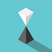Isometric white pyramid standing on black one in unstable equilibrium. Balance, risk, finance, harmony and relationship concept. Flat design. Vector illustration, no transparency, no gradients