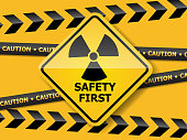 illustration of radiation warning sign on yellow wall vector background