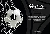 Realistic soccer ball in net isolated in black background. Classic old football ball