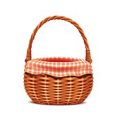 Realistic wicker basket with napkin isolated on white background.