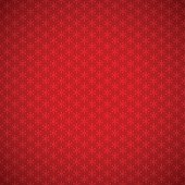 Red festive background of seamless pattern with stylized snowflakes, and vignette