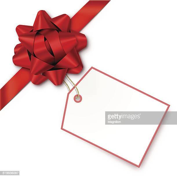 Cadeau avec une étiquette rouge Bow