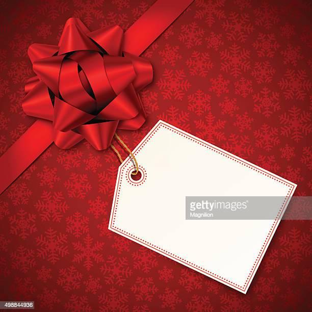 Fond de Noël rouge avec rouge Bow et étiquette
