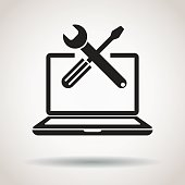 Laptop with screwdriver and wrench repair icon.