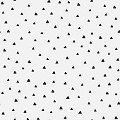 Repeating triangles drawn by hand. Geometric seamless pattern. Vector illustration.