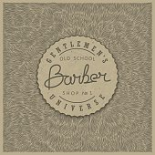 Stylish retro badge for Barber Shop in old style on paper kraft texture. Vector illustration.  Emblem design on the unique shaggy backdrop.