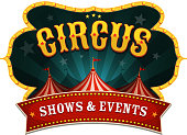 Illustration of a retro circus red poster banner, with marquee, big top, and sunbeams
