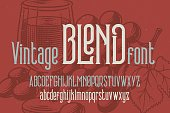 Retro condensed font named 'Vintage Blend' with grapes drawing background.