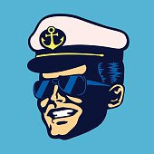 Retro cruise ship captain head with hat and aviator glasses smiling face vintage isolated vector illustration