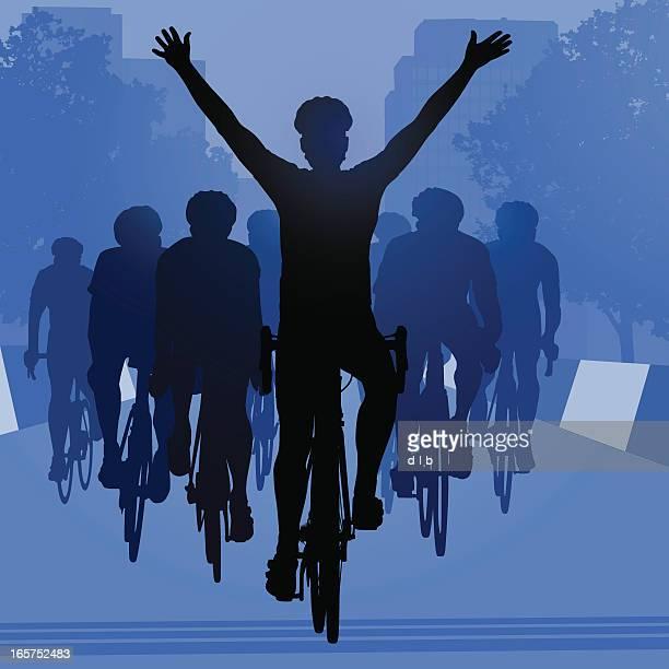 Road Bike Cyclist Winning the Race in an Urban Setting