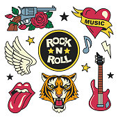 Vector illustration of rock music badges and symbols, such as gun and rose, heart with the ribbon, tiger face, guitar, open mouth and wings. Isolated on white.