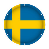 round metallic flag of Sweden with six screw holes in front of a white background