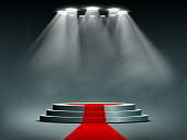 Round podium illuminated by searchlights. Red carpet. Blank background for the presentation. Stock vector illustration.