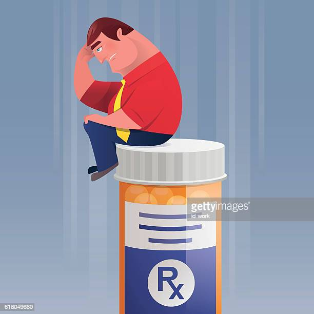 sad businessman sitting on pill bottle and thinking