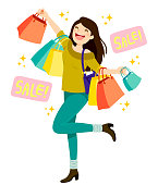 Happy young woman holding shopping bags and enjoying sales