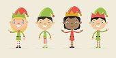 Cute little children dressed as Santa elves. Flat design style.