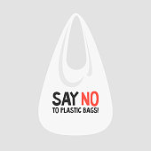 Say no to plastic bags. Female eco activist holding a globe. Ecology conversation. Flat editable vector illustration, clip art