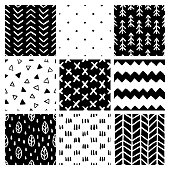 Set of nine hand drawn black and white scandinavian style trendy seamless patterns. Stripes, lines, crosses. Abstract monochrome design elements for different design needs. Vector illustration.