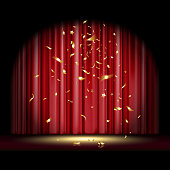 theatrical scene with red curtain and falling gold confetti