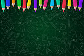 School background with scribbles and coloured pencils. Vector.