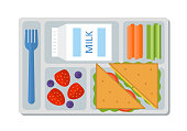 School lunch with a sandwich, fresh berries, vegetables and milk. Flat style. Vector illustration.