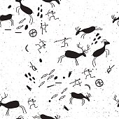 Cave rock painting tribal people silhouettes hunts to animals.Seamless background for your design.