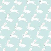 Seamless bunny pattern on blue background