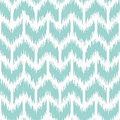 Seamless geometric pattern, based on ikat fabric style. Vector illustration for ikat, traditional oriental fabric dyeing technology. Ikkat pattern with monochrome chevron - teal zig-zag on white backg