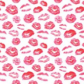 Seamless pattern - red lips kisses prints background. Realistic look lipstick prints.