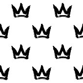 Seamless pattern with crowns isolated on white background. Rough brush painted shapes. Abstract grunge illustration.