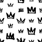 Seamless pattern with crowns isolated on white background. Rough brush painted shapes. Street-style abstract grunge illustration.