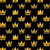 Seamless pattern with golden crowns isolated on black background. Rough brush painted shapes. Ink street-style abstract grunge illustration.
