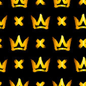 Seamless pattern with golden hand-drawn crowns and crosses on black background. Rough brush painted shapes vector backdrop. Ink street-style abstract grunge illustration.