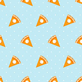 Vector seamless pattern with pumpkin pie slices on a blue background.