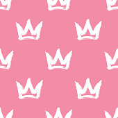 Seamless pattern with white hand-drawn crowns on pink background. Rough brush painted shapes vector backdrop. Doodle style illustration.
