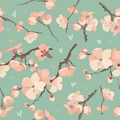Seamless spring flowers on tree branch pattern on blue background