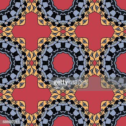 Seamless symmetrical pattern in red and yellow colors. Mandala. Kaleidoscopic : Vector Art