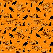 Seamless vector hand drawn pattern with Halloween motif (ravens, bats, spiders, web, pumpkins) on orange background.