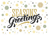 Seasons greetings. Vintage card for winter holidays. Hand lettering calligraphic inscription by brush. Snowflakes on white background. Vector illustration.