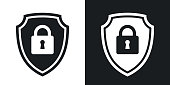 Two-tone version of vector Protective shield icon with the image of a padlock. Security concept simple icon on black and white background