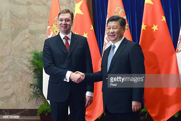 Serbian Prime Minister Aleksandar Vucic shakes hands with Chinese President Xi Jinping before a bilateral meeting after he attended the 4th Meeting...